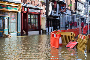 Shops and street in River Severn floodwaters, group of people taking photographs in background. After Storm Ciara and Storm Dennis, the wettest February recorded in the UK. Shrewsbury, Shropshire, Eng...  -  Ashley Cooper