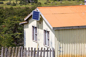 Photovoltaic panel on side of house. Near Puerto Natales, Magallanes, Chile. January 2020.  -  Ashley Cooper