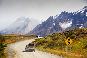 Cars on winding road through mountains. Torres del Paine National Park, Patagonia, Chile. January 2020.  -  Ashley Cooper