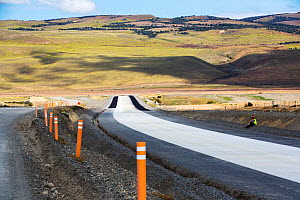 Road building between Cerro Castillo and Torres del Paine National Park to cope with increased tourism in area, concrete replacing gravel road. Patagonia, Chile. January 2020.  -  Ashley Cooper