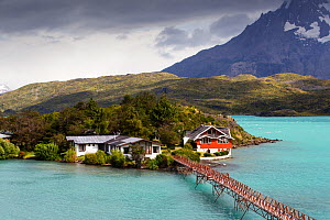 Pehoe Lodge and bridge on Lake Pehoe. Torres del Paine National Park, Patagonia, Chile. January 2020.  -  Ashley Cooper