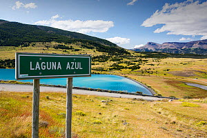 Signpost in front of Laguna Azul. Torres del Paine National Park, Patagonia, Chile. January 2020.  -  Ashley Cooper