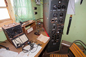 Radio room in Station W, a former British scientific research station evacuated in 1959. Detaille Island, Graham Land, Antarctica. 2020.  -  Ashley Cooper