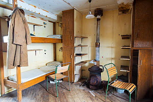Bedroom as it left after researchers evacuated in 1959. Station W, a former British scientific research station. Detaille Island, Graham Land, Antarctica. 2020.  -  Ashley Cooper