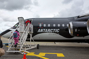 Tourists boarding plane during Antarctic tourism trip from Punta Arenas, Chile. South Shetland Islands, Antarctica. December 2019.  -  Ashley Cooper