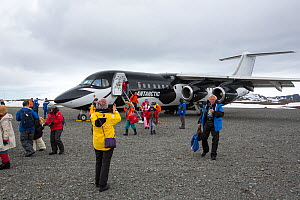 Tourists landing at Frei Station during Antarctic tourism trip from Punta Arenas, Chile. King George Island, South Shetland Islands. December 2019.  -  Ashley Cooper