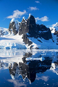Mountain peaks and glaciers reflected in Lemaire Channel between Booth Island and the Kiev Peninsula, Antarctica. December 2019.  -  Ashley Cooper