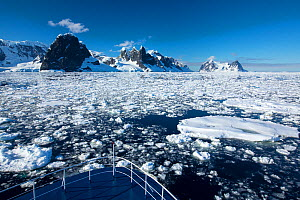 Peaks on the side of Lemaire Channel between Booth Island and Kiev Peninsula, view above from bow of expedition cruise ship. Antarctica. December 2019.  -  Ashley Cooper