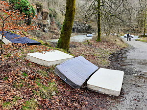 Mattreses fly tipped and illegally dumped in car park. White Moss, near Ambleside, Lake District National Park, England, UK. February 2020.  -  Ashley Cooper