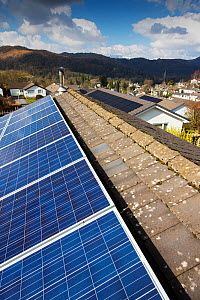 Photovoltaics on roofs of houses, hills in background. Ambleside, Lake District National Park, Cumbria, England, UK. March 2020.  -  Ashley Cooper