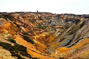 Opencast copper mine, rocks stained by copper and iron sulphide minerals. Parys Mountain was the world's largest copper mine in the 18th century. Amlwch, Anglesey, Wales, UK. July 2019.  -  Graham Eaton