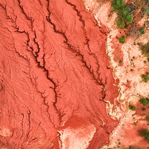 Red mud deposits, with cracks forming. Red mud / alumina storage facility . Alumina is a highly alkaline waste product from the aluminium industry.  -  Milan Radisics