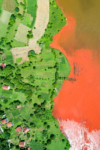 Aerial view of red mud deposits in storage pond. A highly alkaline waste product produced by the industrial production of aluminium at factory 5 miles away. Bosnia and Herzegovina.  Locals have said m...  -  Milan Radisics