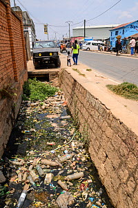 Plastic litter including bottles in gutter. Mandroseza, Antananarivo, Madagascar. 2019.  -  Terry Whittaker
