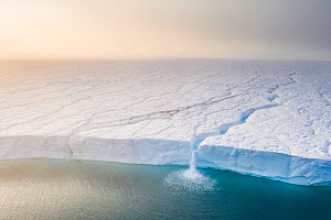 Melting ice sheet with  massive  waterfalls running off the Austfonna glacier, the third largest glacier in the world covering most  of Nordaustlandet island, eastern Svalbard, Norway.  Winner of True...  -  Roy Mangersnes