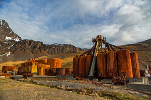 Rusty vats used to cook blubber and store oil at Grytviken, the largest former whaling station on South Georgia. November 2017.  -  Mark MacEwen