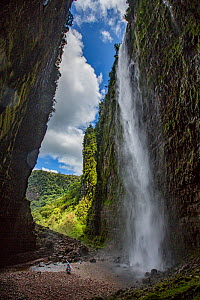 Angel Falls, the world's highest uninterrupted waterfall with a fall of 807m, flowing from Auyan-tepui, a table-top mountain. Helicopter used in filming at base of waterfall with people beside it....  -  Mark MacEwen
