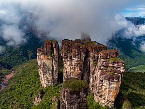 Helicopter with film camera mounted, on tepui table-top mountain, aerial view. Taken on location for BBC Seven Worlds One Planet series. Canaima National Park, Venezuela. 2018.  -  Mark MacEwen