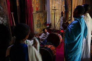Deacons and students singing during Sunday service at Debre Sina Orthodox Church. Near Gorgora, Ethiopia. 2018.  -  Bruno D'Amicis