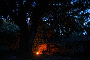 Monks attending fire at night in church forest of Wonchet Michail Orthodox Church. Near Hamusit, Ethiopia. 2018.  -  Bruno D'Amicis