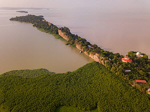 Aerial view of monastery surrounded by church forest on shore of Lake Tana, Tana Qirgos Island in distance. Church forests remain largely intact in a degraded landscape as they are considered sacred....  -  Bruno D'Amicis