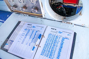 Nitrox log book of the live-aboard vessel Nai'a, Fiji. Each diver using a nitrox mixture fills out this form for each dive.  -  David Fleetham
