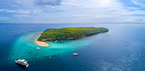 Aerial view of the sand bar and reef off the corner of Sumilon Island, a tiny island off the coast of Bancogon, Cebu, Philippines. A live-aboard scuba diving vessel is moored just offshore.  -  David Fleetham