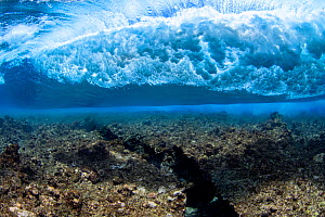 Underwater view of surf crashing over reef off the island of Yap in Micronesia.  -  David Fleetham