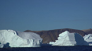 Tracking shot in transit of a large icebergs, Cape York, Greenland, September.  -  Fred Olivier