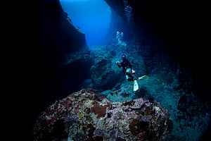 "A diver in the opening of the ""Cathedral"", a cavern, Green Island, Taiwan.  -  Magnus Lundgren / Wild Wonders of China"