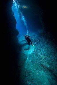 Diver in the Catherdral, a famous underwater cavern, Green Island, Taiwan.  -  Magnus Lundgren / Wild Wonders of China