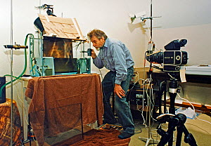 Stephen Dalton preparing set-up in his studio for archerfish high-speed photography. The set-up is not yet complete and lacks the surrounding black that was added later to reduce reflections.  -  Stephen  Dalton