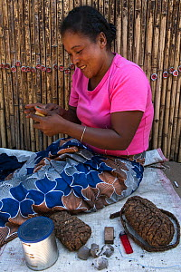 Woman with tobacco for sale, local market, South Madagascar. October 2018.  -  Pete Oxford