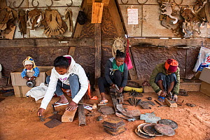 Deaf workers, in metal factory, making metal artefacts for tourist industry, Antananarivo, Madagascar. October 2018.  -  Pete Oxford