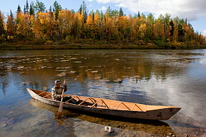 Selkup man, Gennadiy Kubolev, in dug-out canoe known as an anty, heading fishing on River Shirta. Krasnoselkup, Yamalo-Nenets, Western Siberia, Russia.  -  Bryan and Cherry Alexander
