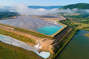 Aerial view of ash pond, Montenegro. After coal is burned in power plants, the waste ash is mixed with water and pumped through pipelines into sludgy lagoons commonly known as ash ponds. The ponds are...  -  Milan Radisics