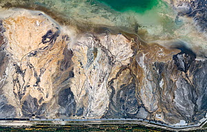 Aerial view of ash pond near city of Lodz, Poland. After coal is burned in power plants, the waste ash is mixed with water and pumped through pipelines into sludgy lagoons commonly known as ash ponds....  -  Milan Radisics