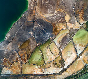 Aerial view of ash pond near Turek, Poland. Former open pit coal mine now used to store coal ash after burning in power plants. The ash is mixed with water and pumped through pipelines (fixed on sand...  -  Milan Radisics