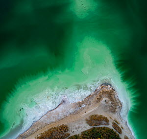 Aerial view of ash pond near Turek, Poland. Former open pit coal mine now used to store coal ash after burning in power plants. The ash is mixed with water and pumped through a pipeline into the ash p...  -  Milan Radisics