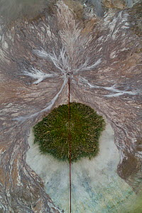 Aerial view of pipeline in ashpond in Szczecin, Poland. After coal is burned in power plants, the waste ash is mixed with water and pumped through pipelines into sludgy lagoons commonly known as ash p...  -  Milan Radisics
