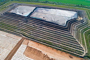 Aerial view of coal ash pyramid in East-Central Europe. After coal is burned in power plants, the waste ash is stacked layer-by-layer and compacted into large pyramids, which may eventually be covered...  -  Milan Radisics