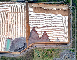 Aerial view of newly created ash pond with first dose of ash, East-Central Europe. After coal is burned in power plants, the waste ash is mixed with water and pumped through pipelines into sludgy lago...  -  Milan Radisics
