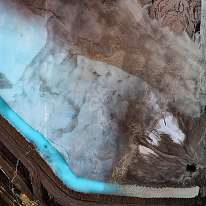 Aerial view of ash pond in East-Central Europe. After coal is burned in power plants, the waste ash is mixed with water and pumped through pipelines into sludgy lagoons commonly known as ash ponds. Th...  -  Milan Radisics