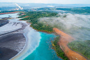 Aerial view of ash pond near coal power plant visible in the background, Bosnia and Herzegovina. After coal is burned in power plants, the waste ash is mixed with water and pumped through pipelines in...  -  Milan Radisics