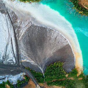 Aerial view of ash pond on the edge of a forest, Bosnia and Herzegovina. After coal is burned in power plants, the waste ash is mixed with water and pumped through pipelines into sludgy lagoons common...  -  Milan Radisics