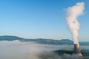 Cooling tower of thermal power plant in Montenegro, surrounded with fog.  -  Milan Radisics