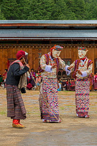 Haa Tsechu festival at the 'white chapel'. The Pholay Molay masked dance (the dance of the noble men and ladies). Bhutan. September 2013.  -  Jeff Foott