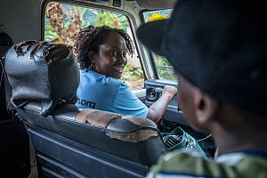 Dr. Gladys in the passenger seat of the CTPH truck as they head out to speak with people in nearby communities. Bwindi Inpenetrable Forest, Uganda. April 2016.  -  Jo-Anne McArthur / We Animals