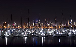 View of Melbourne skyline at night from St Kilda pier, looking over Royal Melbourne yacht club vessels. St Kilda, Victoria, Australia. December 2015  -  Doug Gimesy