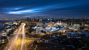 A view at dusk over iconic Luna Park, a historic amusement park opened in 1912, and the St Kilda foreshore of Port Phillip Bay. St Kilda, Victoria, Australia. May 2016  -  Doug Gimesy